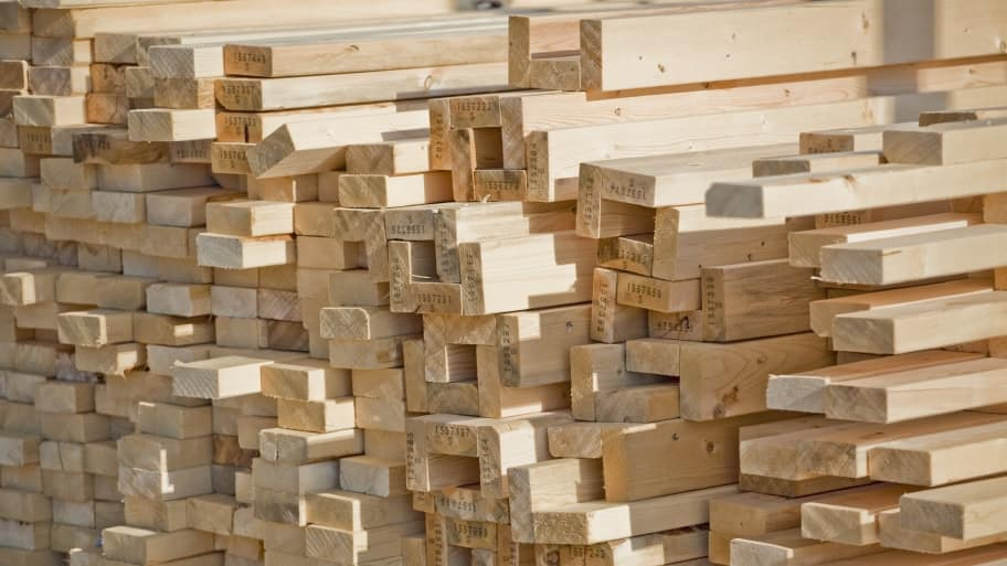 lumber stacked for home construction