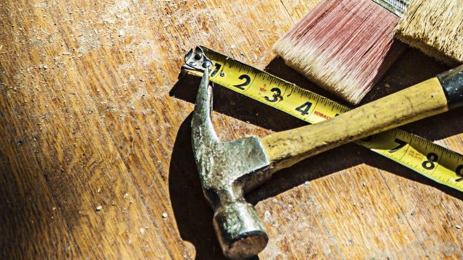 hammer, tape measure, and brush