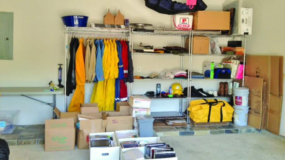 Shelves and boxes of neatly organized items in garage.