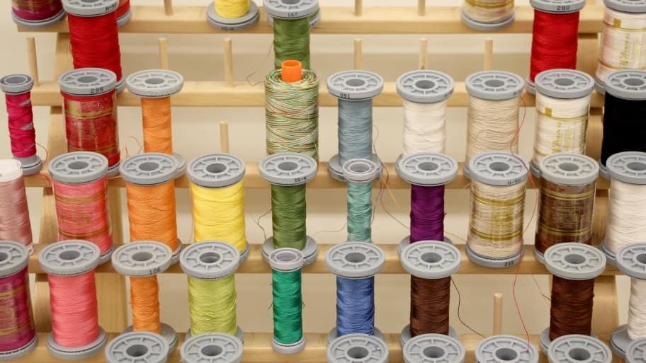 all colors of the rainbow thread spools