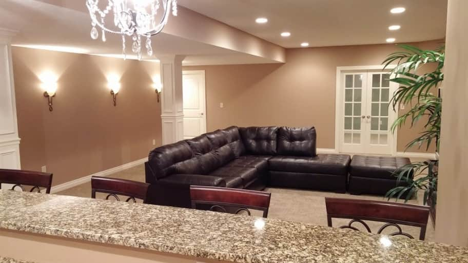 new paint, leather sectional, bar countertop in basement