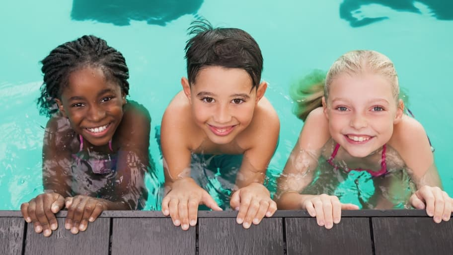 three children in a swimming pool