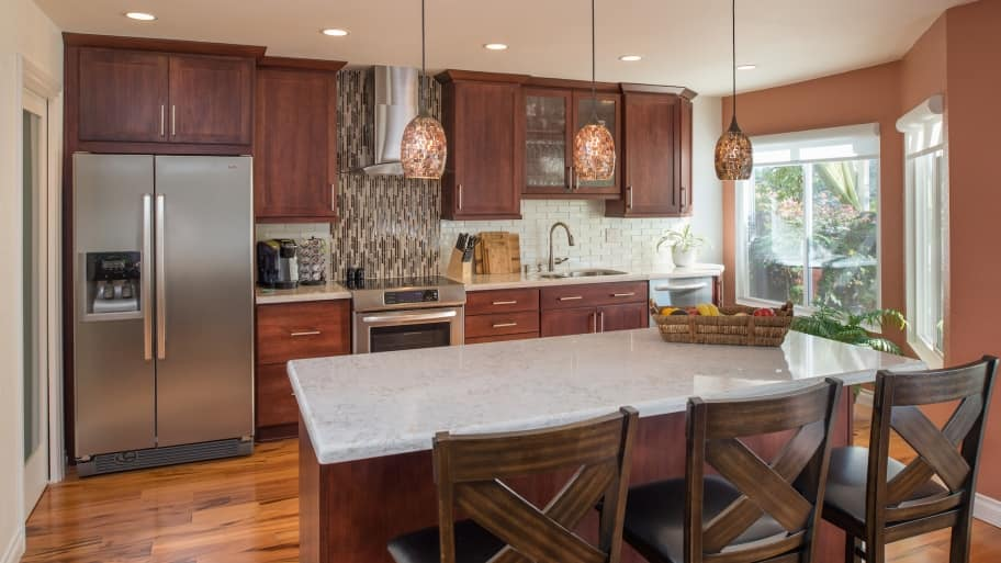 Newly remodeled kitchen with tile backsplash and new countertops