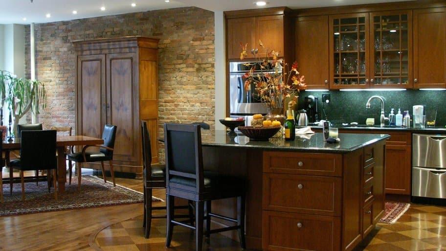dark wood kitchen island with bar stools