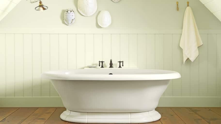 clean white freestanding soaker bathtub