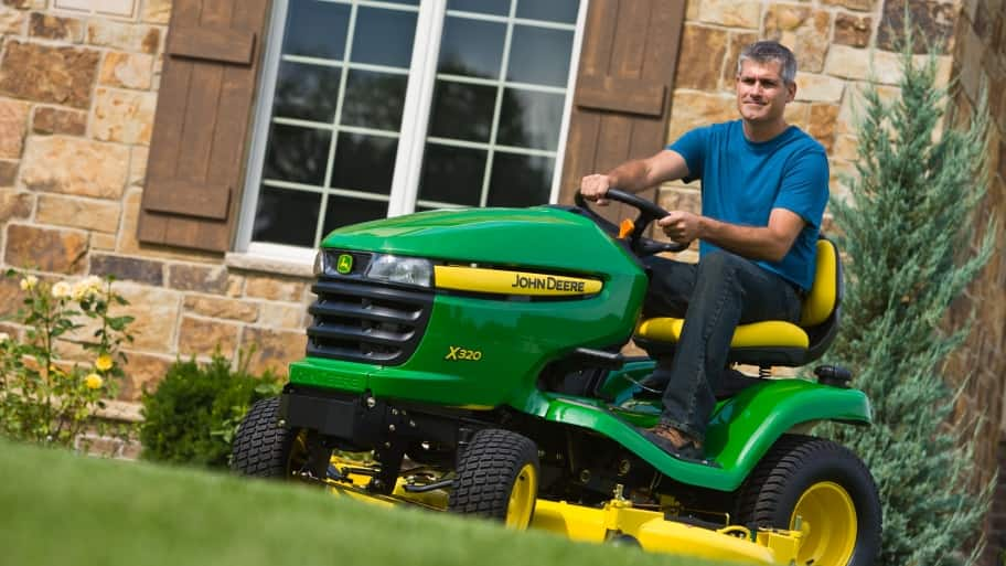 man on lawn tractor