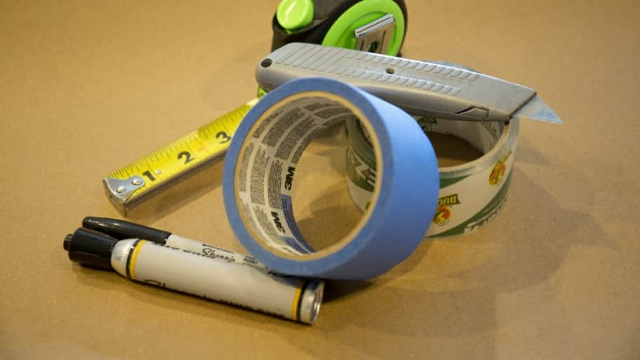 Tape, tape measure, box cutter, markers and toolbox