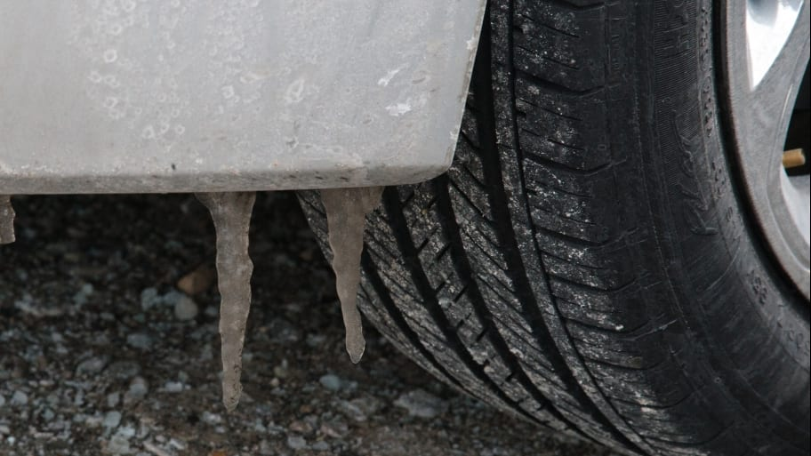 car tire on salt-covered road