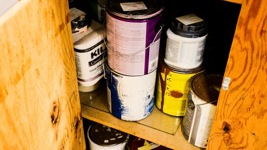 paint cans in a cabinet