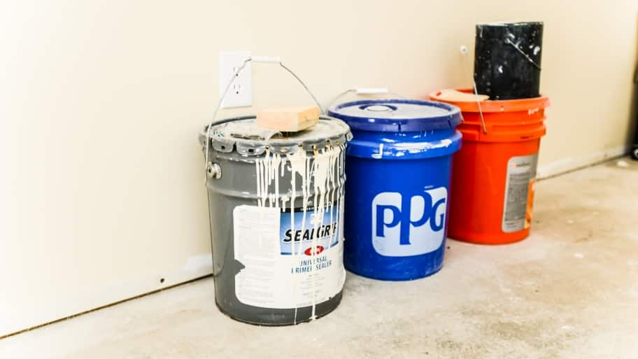 buckets of paint and sealers