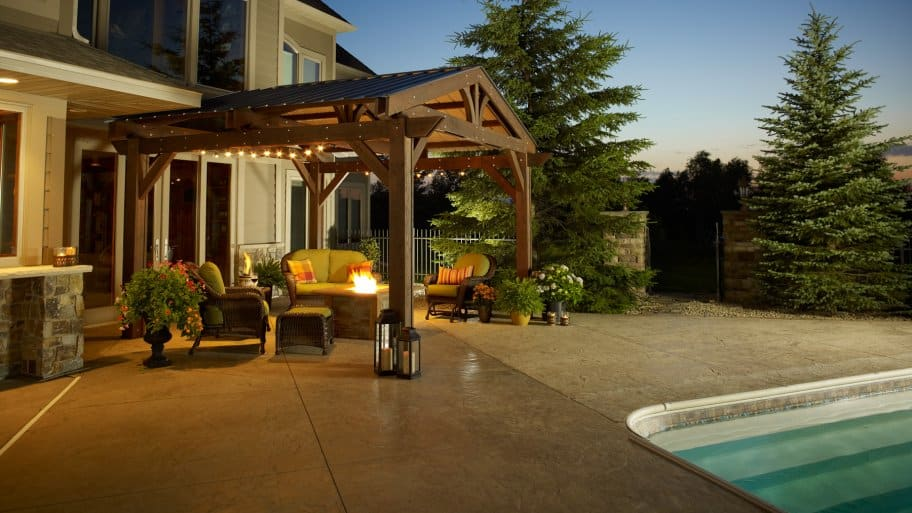 swimming pool with pergola and fire pit