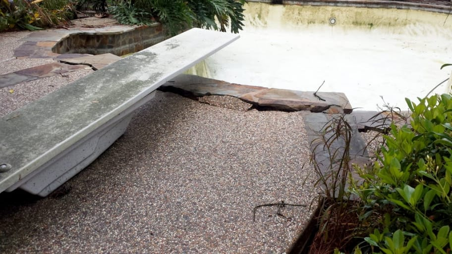 old pool popping out of the ground
