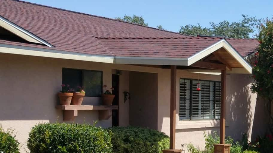 one-story house with new red roofing shingles