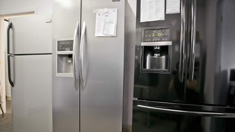 white, stainless steel and black refrigerators (Photo by Brandon Smith)