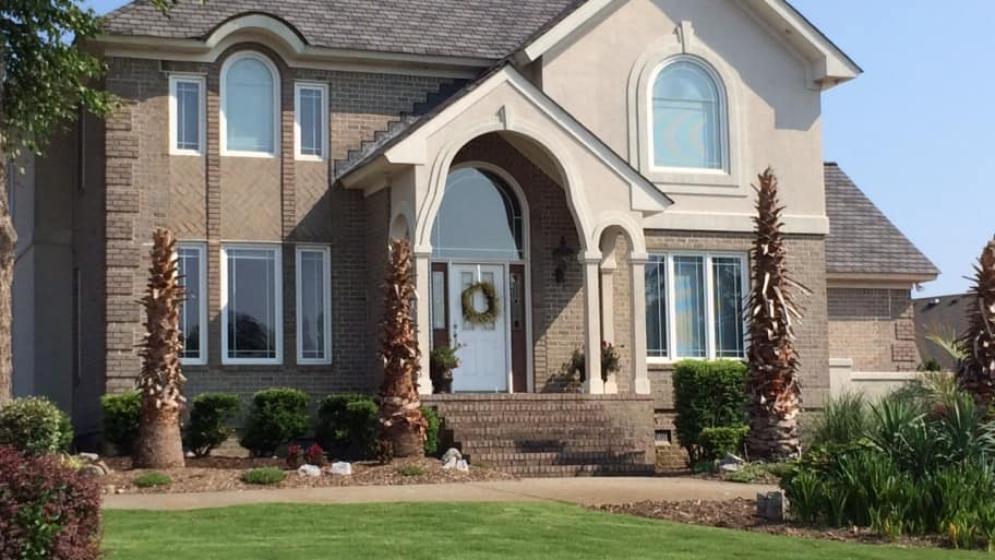 replacement windows two story brick stucco house