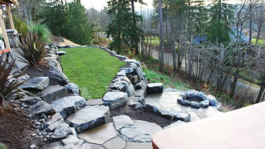 Patio slate used to build steps and walking area to a firepit and outdoor hot tub and spa area.