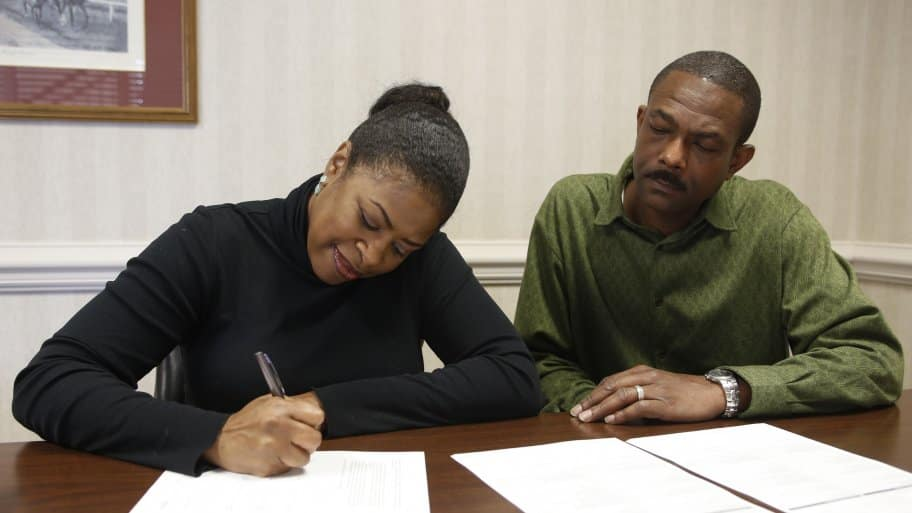 couple signing a notarized document