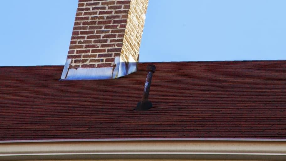 asphalt shingle roof and chimney