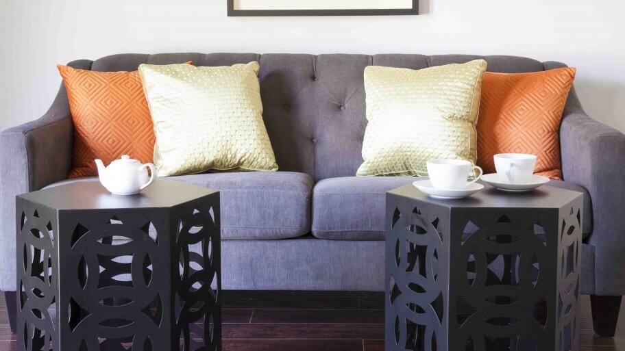 couch with four throw pillows