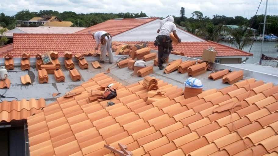 roofers installing tile shingle roof on Florida home