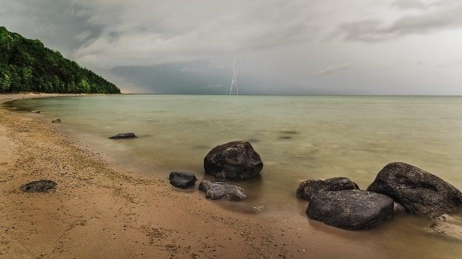 lightning storm on beach photo