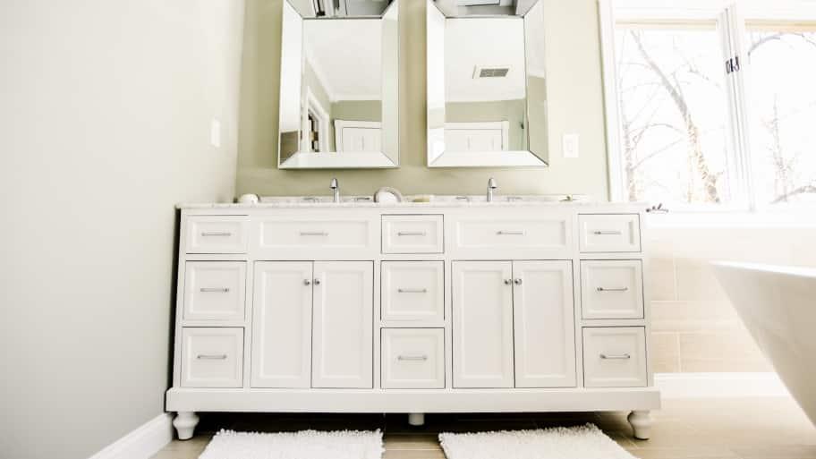 white glazed bathroom sink vanity and cabinets