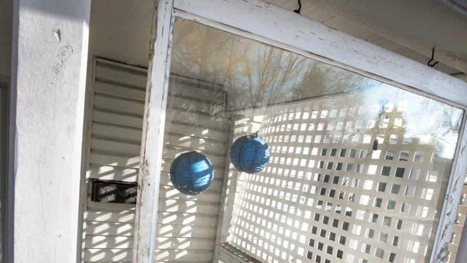 salvaged window porch divider