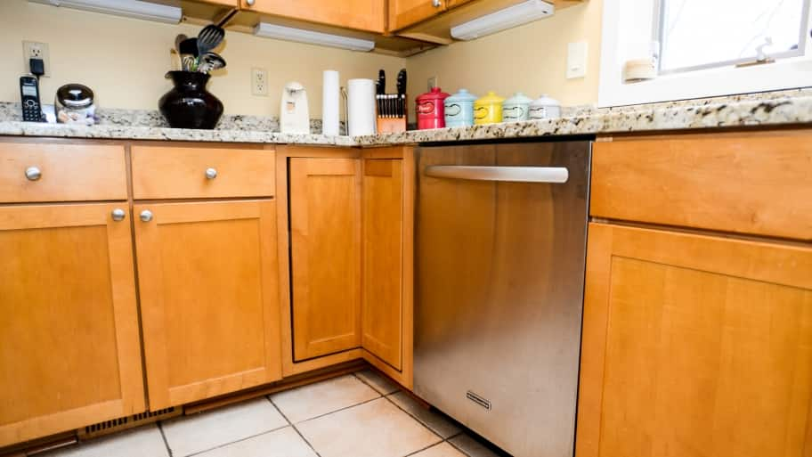 wood cabinets in a green kitchen