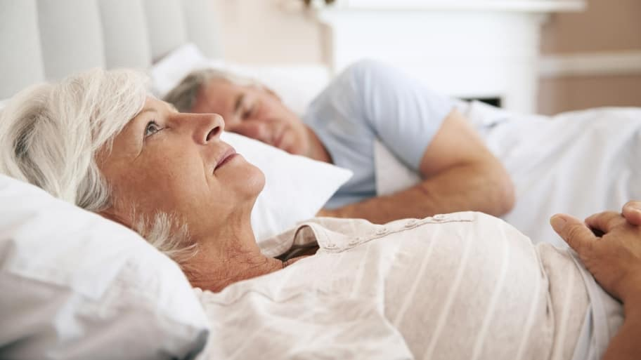 elderly woman awake in bed