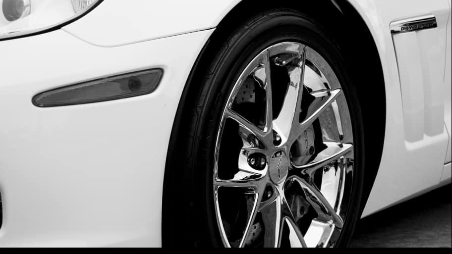 white car with chrome rim