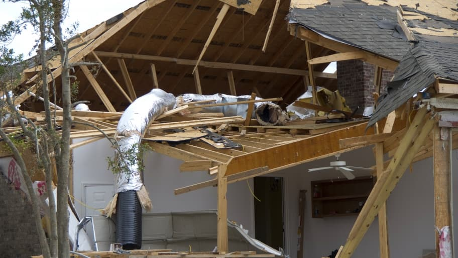 storm-damaged home
