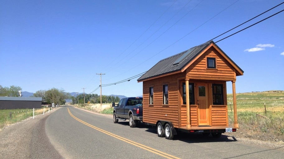 truck pulling tiny house