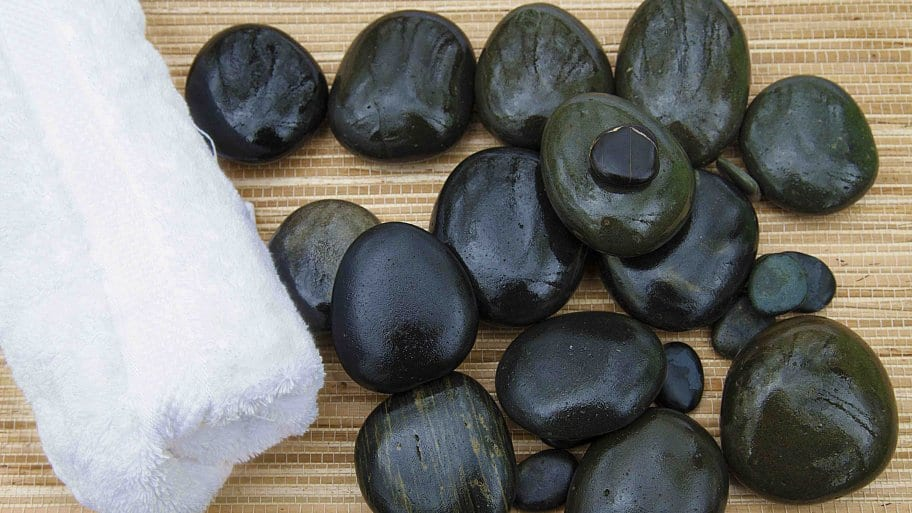 towel and rocks for massage