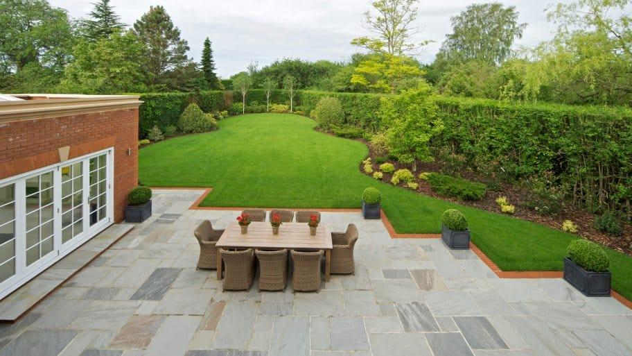 Backyard with level yard and stone patio