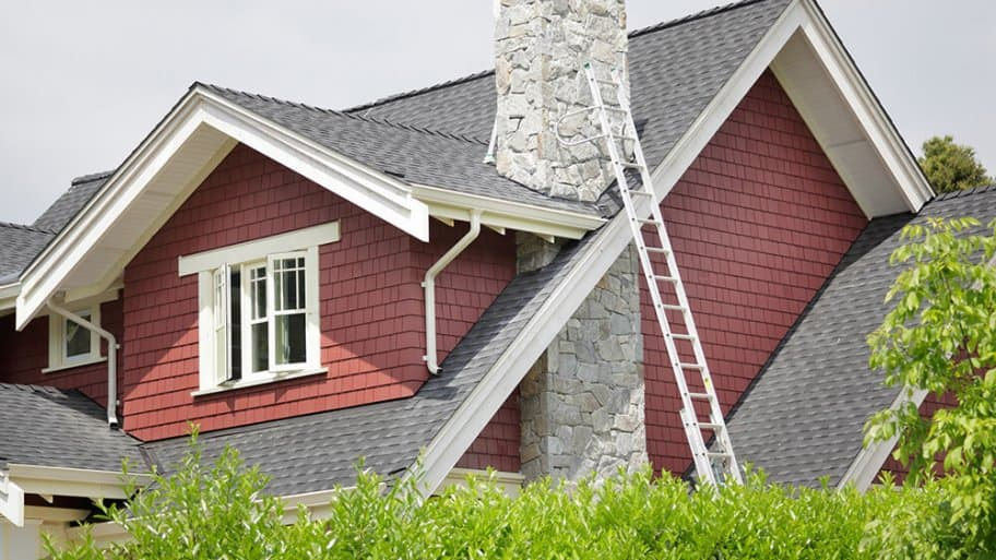Ladder against house with chimney