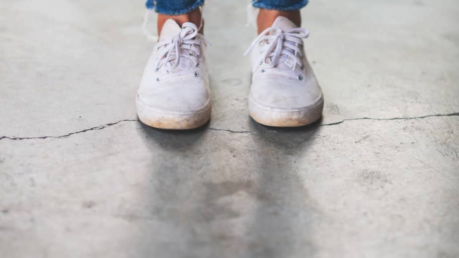 Woman standing on a cracked floor