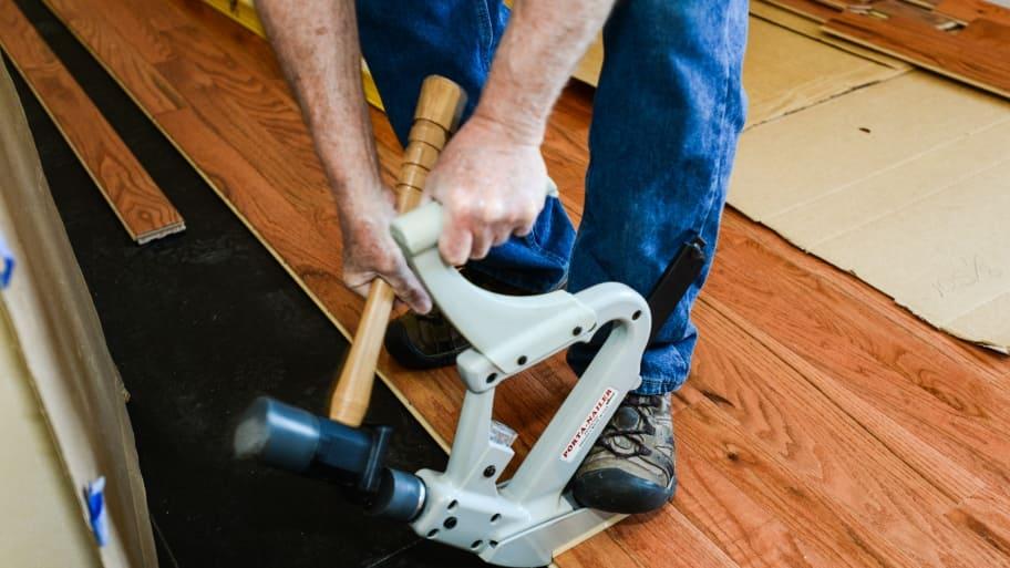 worker installing flooring