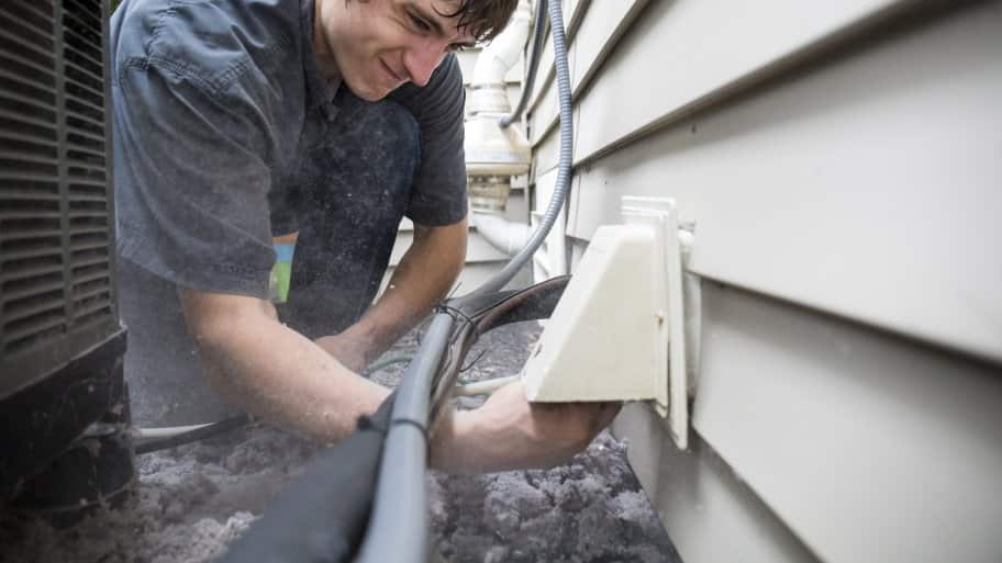 man cleaning dryer vent