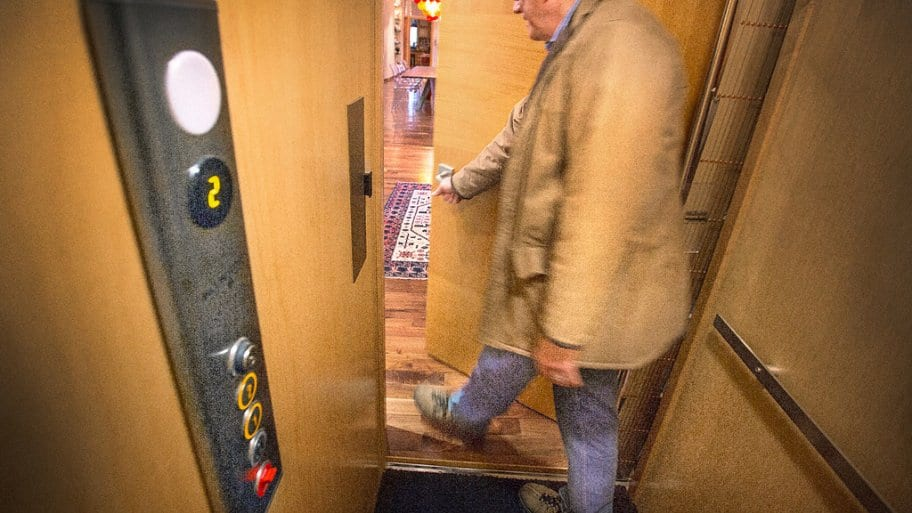 Man exiting his home elevator
