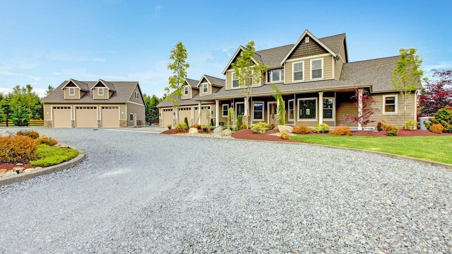 Home with long gravel driveway