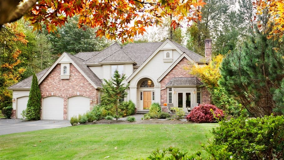 Large house with Fall leaves (Photo by Jo Ann Snover - stock.adobe.com)