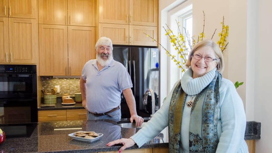 man and woman standing in kitchen