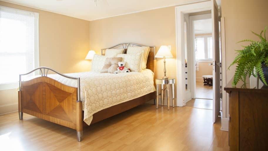 master bedroom with hardwood floors