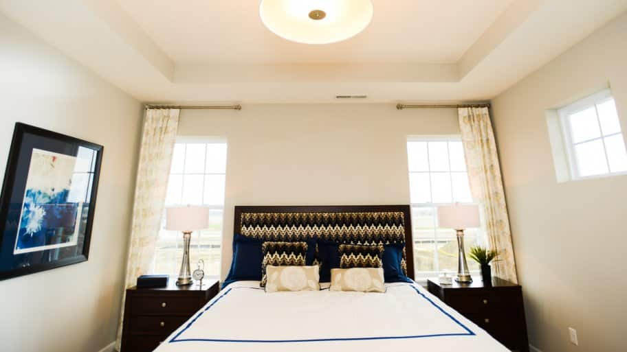 master bedroom with tall windows