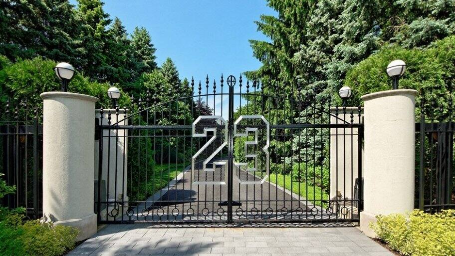 With his iconic jersey number emblazoned on its private gated entrance, Michael Jordan's Highland Park home pays tribute to the basketball legend. (Photo by Photo courtesy of The Agency)