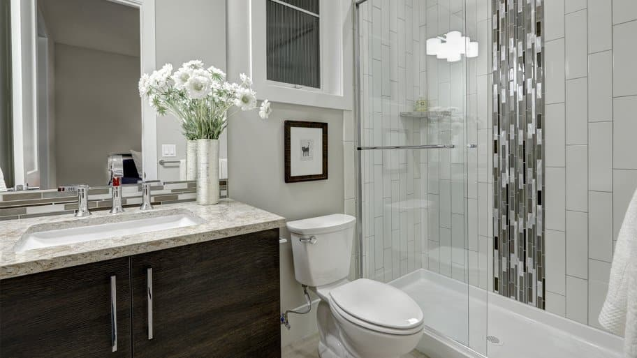 Modern bathroom sink, toilet, and shower