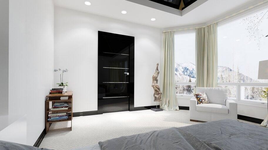 Black door in a modern bedroom