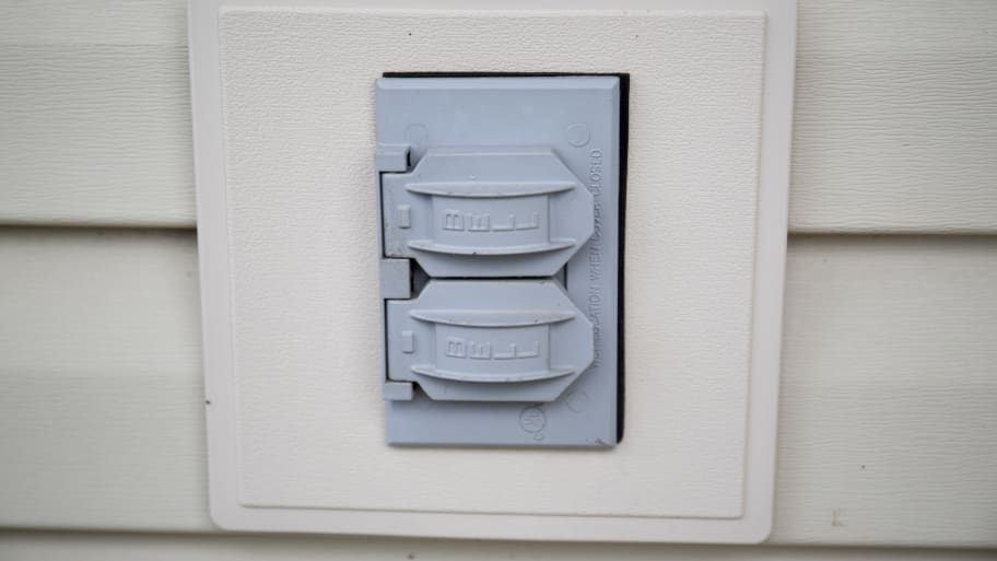 outdoor electrical outlet with gray outlet safety cover (Photo by Eldon Lindsay)
