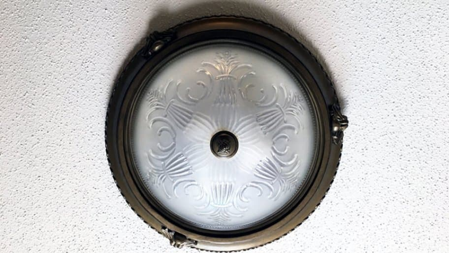 Round mounted ceiling light fixture on a popcorn ceiling