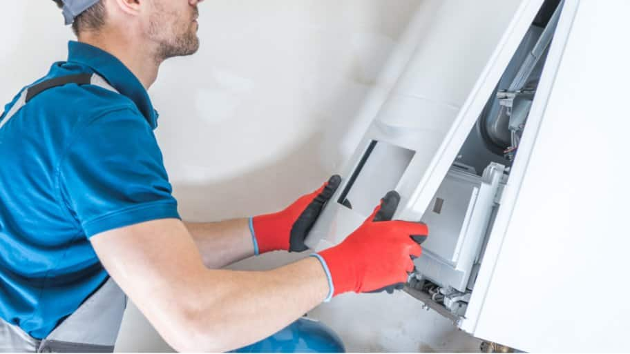 Professional checking a furnace after moving it